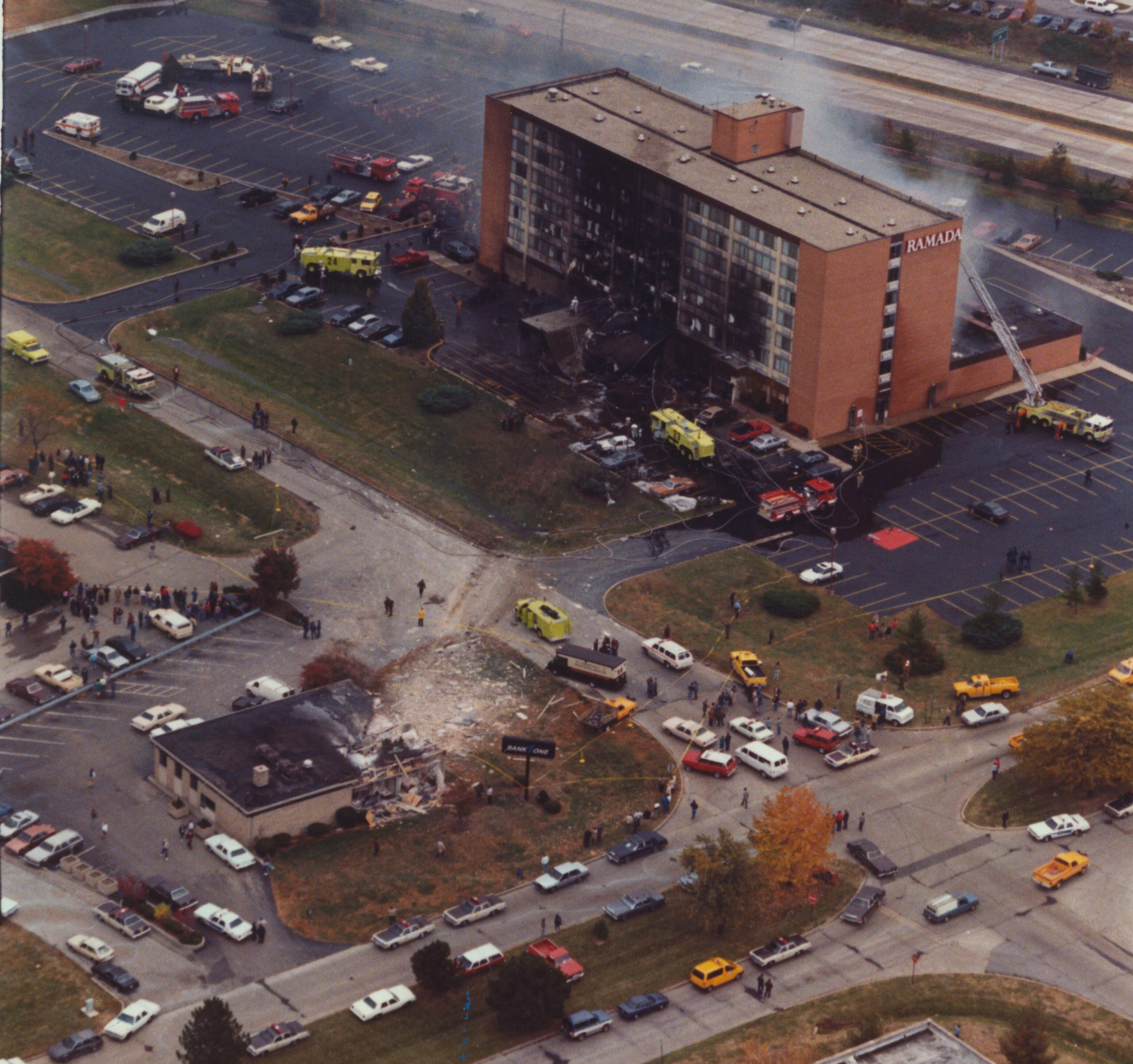 An aerial shot of the destruction caused when a military jet crashed into the Ramada Inn near the Indianapolis International Airport on Oct. 20, 1987. In the foreground is the Bank One branch where the jet bounced off the roof.