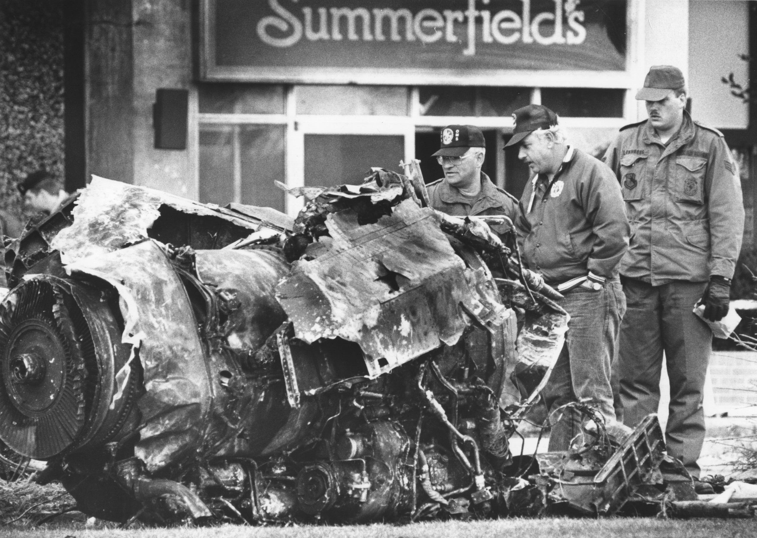 Aviation experts study the remains of a military jet that crashed into the Ramada Inn near the Indianapolis airport on Oct. 20, 1987.