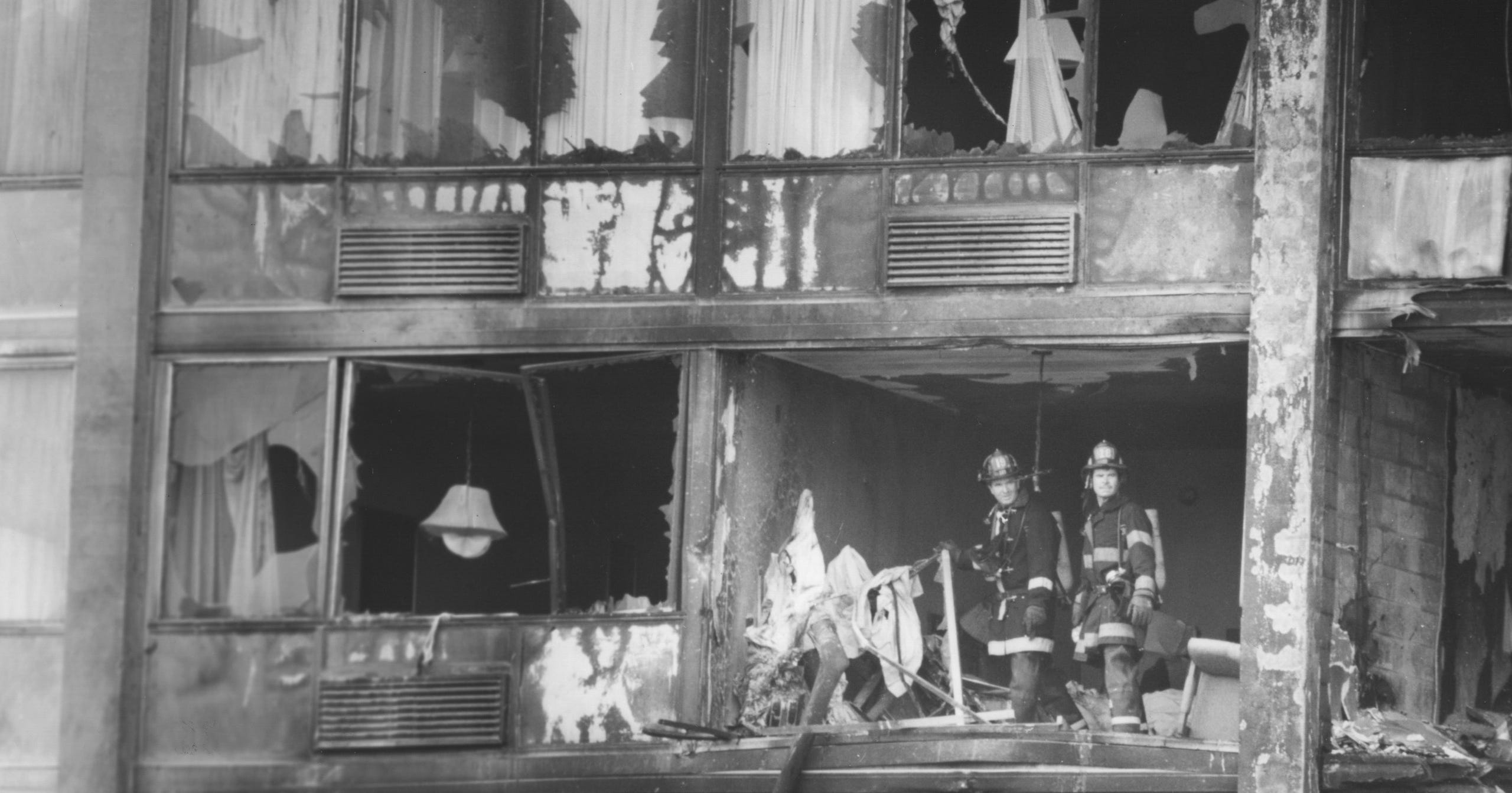 Firefighters review the scene at the Ramada Inn after the hotel was struck by a crashing plane on Oct. 20, 1987. As the plane hit the hotel, the cockpit and engine went into the lobby, killing nine people. Another person died a week later from burn injuries. The wings went into the upper floors of the top of the carport and upper floors of the hotel.