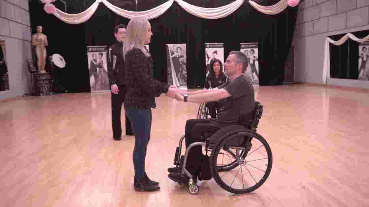 Father-daughter won\'t let wheelchair slow wedding dance