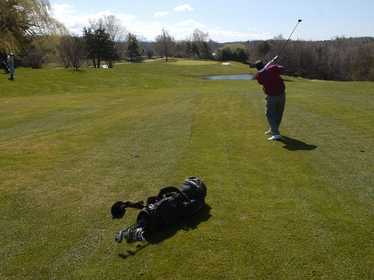 A golfer hits on the fifth hole at Kwiniaska Golf Club in Shelburne. The course's first six holes lie on the west side of Spear Street — a parcel of land under consideration for a housing development.