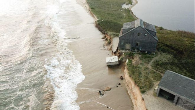 This house at 289 Hummock Pond Road perches precariously on the bluff eroded away by waves generated by Hurricane Paulette September 15. Hurricane Teddy, well offshore, continued to impact the property this week, leading to the demolition of a garage and another house.