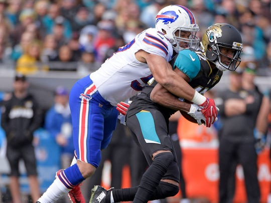 Jacksonville Jaguars wide receiver Dede Westbrook, right, makes a reception in front of Buffalo Bills outside linebacker Lorenzo Alexander, left, in the first half of an NFL wild-card playoff football game, Sunday, Jan. 7, 2018, in Jacksonville, Fla. (AP Photo/Phelan M. Ebenhack)