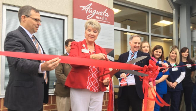 Sylvia Bailey, practice administrator, cuts the ribbon for the opening of a new Augusta Health Specialty clinic in Lexington, Va., on Saturday, Nov. 4, 2017.
