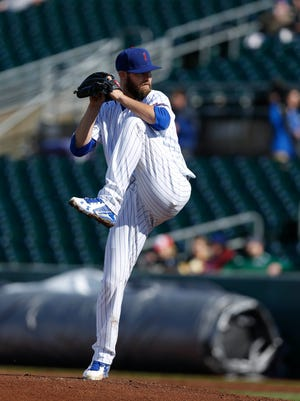Iowa Cubs pitcher Ryan Williams pitches against Round Rock as the clouds break up Thursday, April 7, 2016, during their season opener at Principal Park in Des Moines.