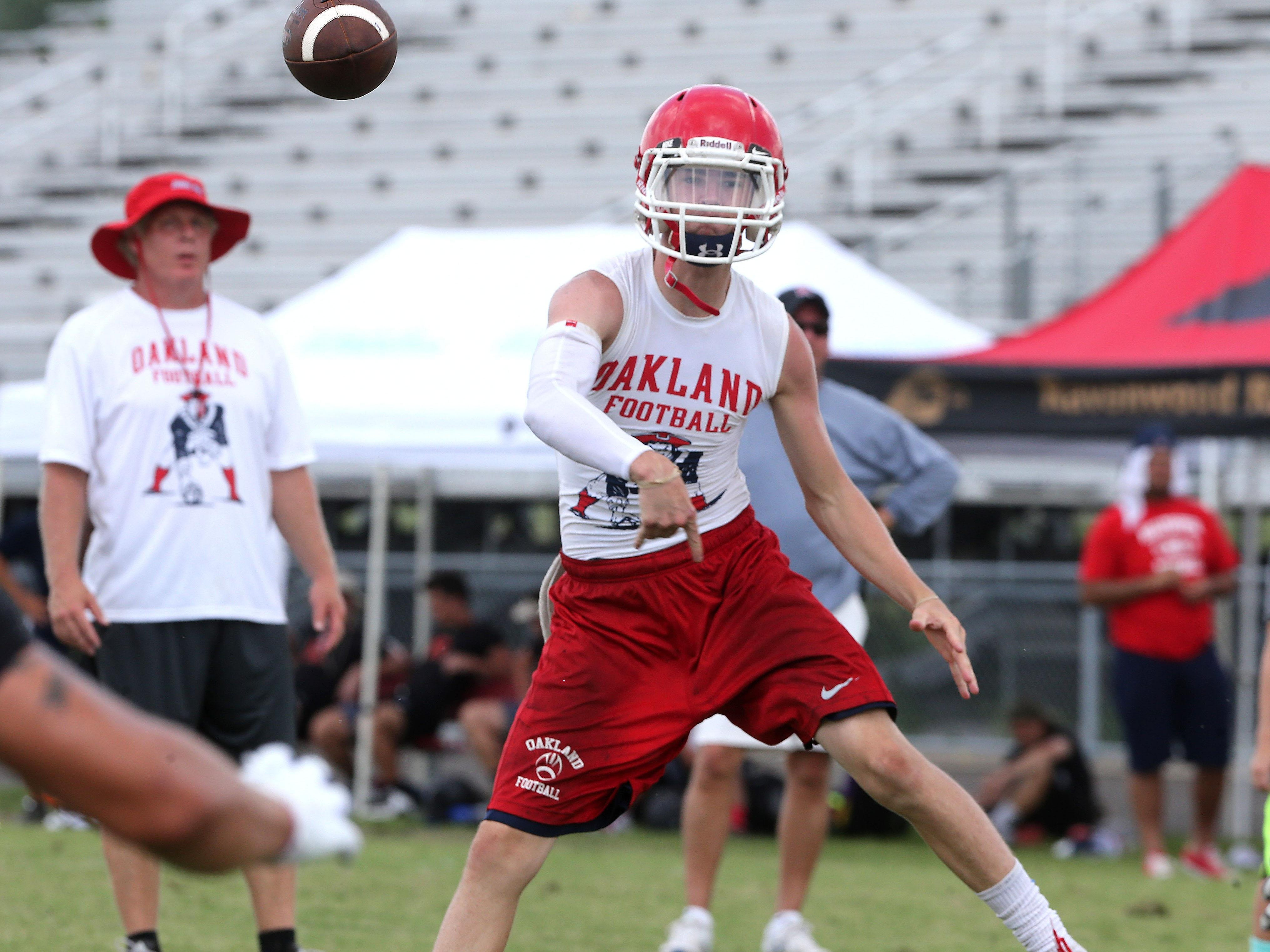 Oakland quarterback Cody Miller throws a pass during the Ravenwood 7-on-7 Passing Tournament Saturday.