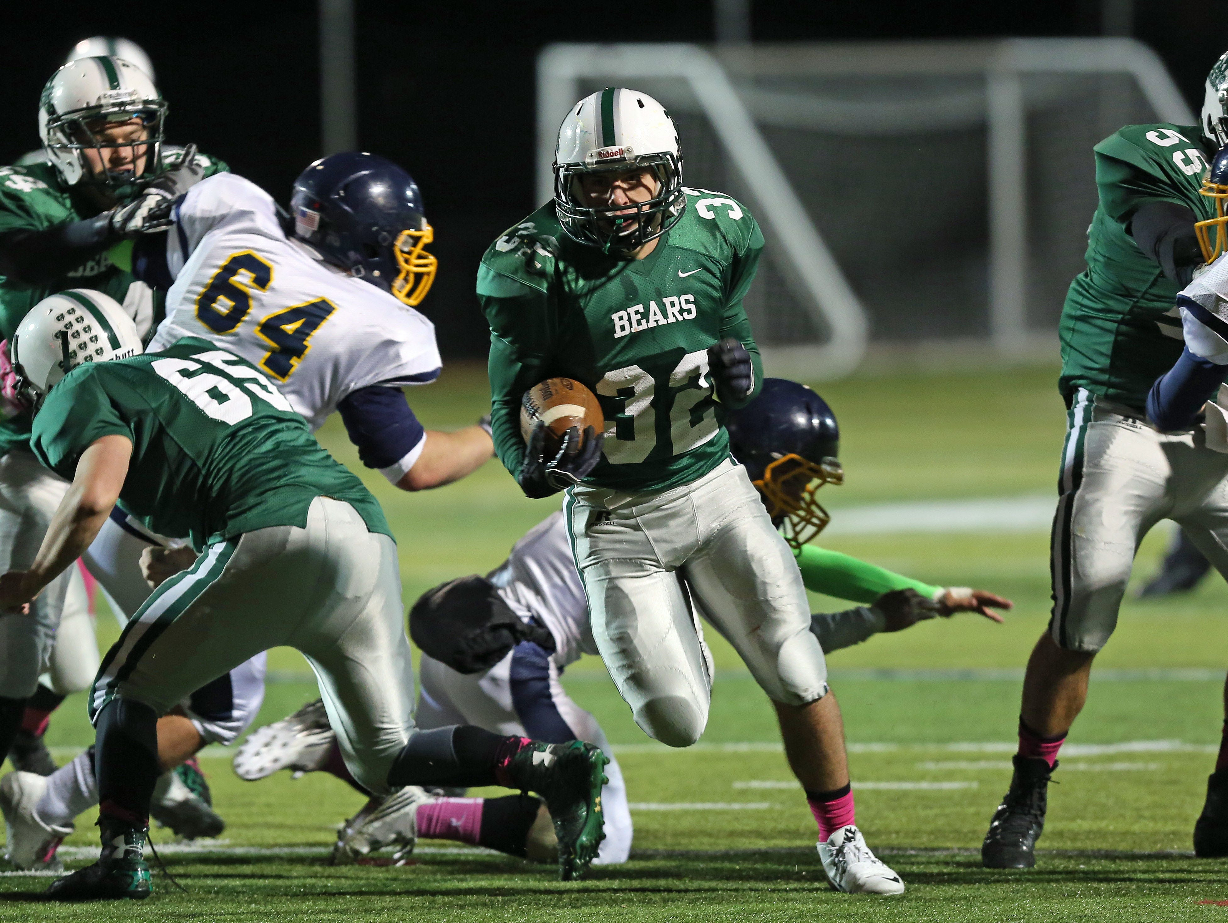 Brewster's Jeremy Meissner (32) breaks a tackle as he runs for a first half touchdown against Panas during football action at Brewster High School Oct. 17, 2015.