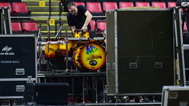 Crews set up the stage and ready instruments for KC & The Sunshine Band at the Floyd L. Maines Veterans Memorial Arena on Friday, August 3, 2018. The concert, which is part of Spiedie Fest, was moved inside because of rain.
