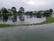 A retention pond overflows off U.S. 1 near Jensen Beach