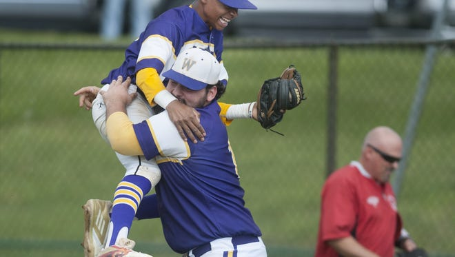 Cherry Hill West's Isaiah Ishmail jumps into the arms of teammate Jake Campbell after Cherry Hill West beat Vineland, 4-3,  in the South Jersey Group 4 playoff game on Tuesday.