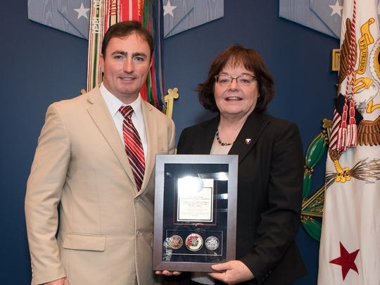 Terrie Doom and Dustin House hold the award for Letterkenny Army Depot   at the Army's 10th annual LEAP Award ceremony.