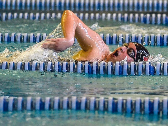 Harding's John Green closes in on his final lap of the boys 200-yard freestyle during the MOAC Swimming Championships held at the YMCA in Marion, Ohio on Saturday. Green finished seventh.