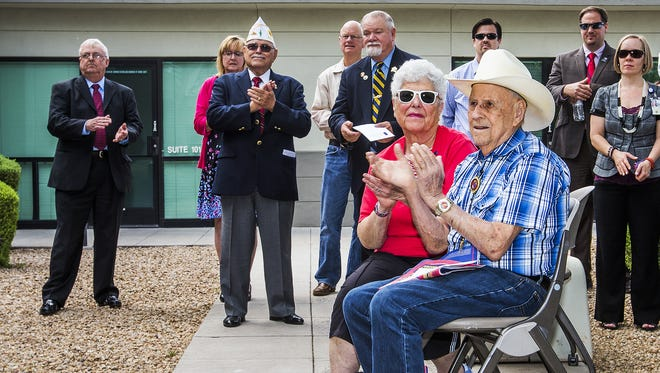 Korean War Marine Corps veteran Stan Rosen, 85, and his wife, Beverly Dajches, 78, applaud during a dedication ceremony for the new Northeast VA Community Based Outpatient Clinic in Scottsdale on Thursday, May 7, 2015. Rosen said he is thrilled with the facility.