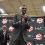 Grant Hill, left, claps during a news conference introducing Dwight Howard as the newest member of the Atlanta Hawks on July 13, 2016, in Atlanta.