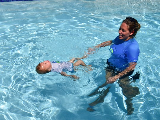 """Cruz, pictured with Kate Armentano, like most children resisted, but is now a """"total water baby and loving it,"""" Kate says."""
