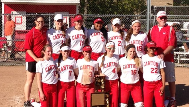 The Canton varsity girls softball team celebrates its Kensington Conference title on Monday after defeating Northville.
