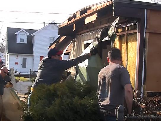 Members of Team Rubicon and Team RWB rip the siding