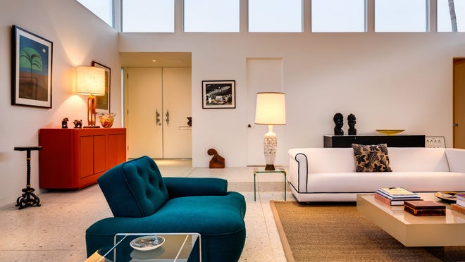 When renovating the home, Collins retained the sunken effect of the living room, adding matching terrazzo flooring on the upper level. The blue chair was reupholstered with discarded theater curtains he retrieved in 1996 from a dumpster outside Webber Douglas Academy of Art in London, England.