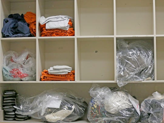 Inmate clothing and personal items are stored on shelves in the pre-booking area of the Milwaukee County Jail.