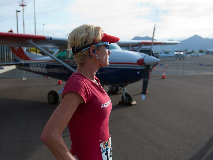 A runner looks onward before the start of the race at the Scottsdale Airport on April 5, 2014. Run the Runway is a 5k and 10K race held on the Scottsdale Airport tarmac. Runners get a chance to view helicopters and small airplanes before taking off down the runway.