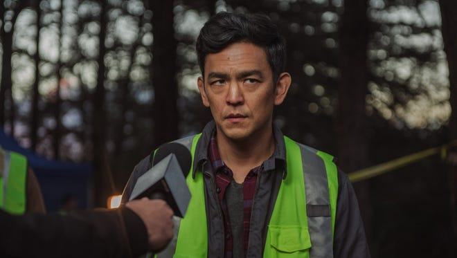 "David (John Cho) is interviewed about his missing daughter in ""Searching."""