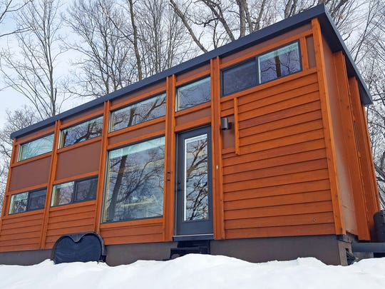 The Traveler XL at Canoe Bay's ESCAPE Village is perched alongside Mallard Lake.