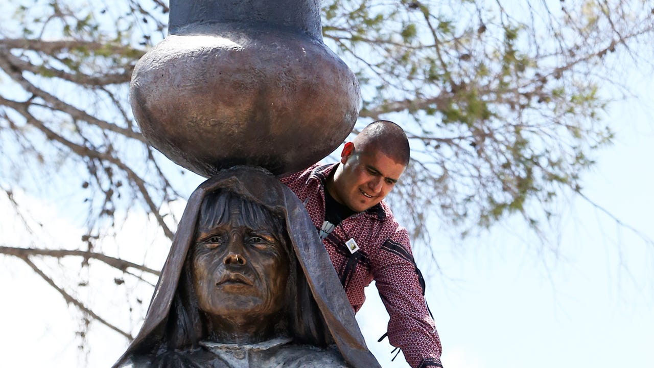 A statue of a Tigua woman named Nestora Granillo Piarote is unveiled during a dedication ceremony at the Tigua Indian Cultural Center at 305 Yaya Lane at Socoaro Road Sunday.