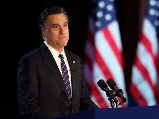 Mitt Romney concedes the presidency to Barack Obama