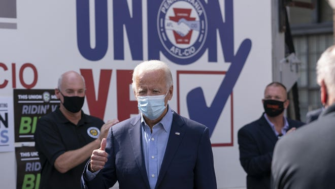 Democratic presidential candidate former Vice President Joe Biden gives the thumbs up as he arrives to pose for photographs with union leaders outside the AFL-CIO headquarters in Harrisburg on Monday, Sept. 7, 2020. (AP Photo/Carolyn Kaster)