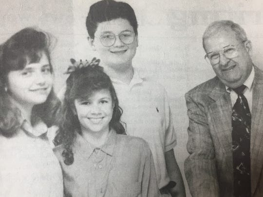 The top TIP winners in May 1993 were, left to right, Emily Wolfe, Miranda Thomas, and Jon Mark Jenkins. Pictured with them is H.T. Shouse of Morganfield National Bank, who sponsored a luncheon in their honor and gave $50 savings bonds to each of the winners.