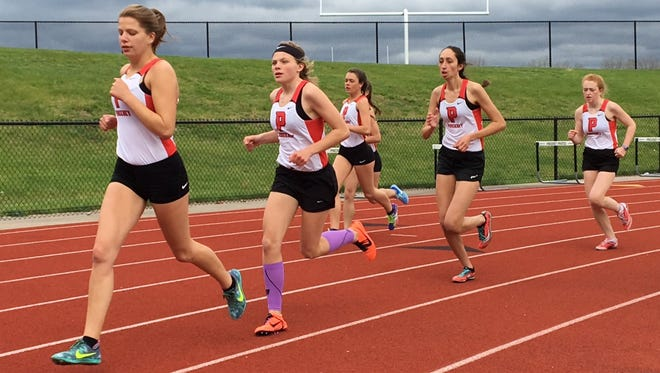 Pinckney's Isabella Garcia (left) has the fastest 3,200-meter run time in Livingston County this spring. Teammate Noelle Adriaens (second from left) is No. 2 in the 1,600 and 3,200.