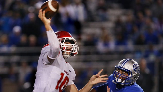 HSE Royals linebacker Collin Miller pressures Fishers Tigers quarterback Zach Eaton as he passes deep in Hamilton Southeastern territory in the fourth quarter, en route to the Tigers' 41-10 win over the Royals at HSE on Friday, September 12, 2014.
