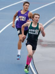 North Union's Riley Bauer pulls ahead of Central Lyon's Gable Sieperda on his way to a win on the 1A boys 1600 meter run Saturday, May 20, 2017, at the state track and field championships at Drake Stadium in Des Moines.