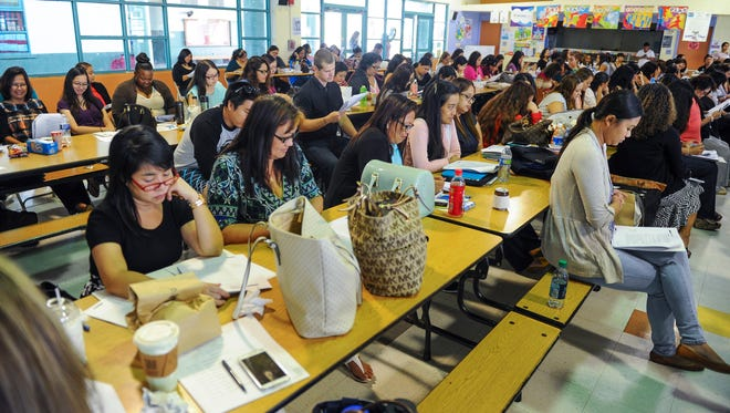 In this file photo, public school teachers, kindergarten through second-grade, attend a child sexual abuse prevention workshop, presented by Guam Attorney General Elizabeth Barrett-Anderson, at C.L. Taitano Elementary School in Sinajana on Friday, Sept. 18.