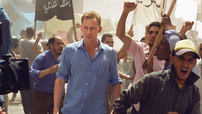 Jonathan Pine (Tom Hiddleston) is living in Cairo during the Arab Spring at the start of AMC's 'The Night Manager.'   as Jonathan Pine - The Night Manager _ Season 1, Episode 1 - Photo Credit: Des Willie /The Ink Factory/AMC