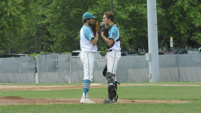 Fond du Lac pitcher Josh Ditter, left, talks strategy with catcher Ryan Norton during Thursday's tournament win over Oshkosh.