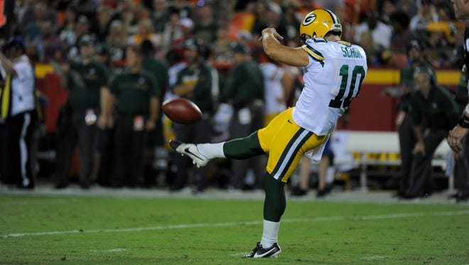 Green Bay Packers punter Jacob Schum (10) punts during the second half against the Kansas City Chiefs.