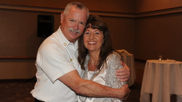 Mesa Fire Chief Harry Beck hugs Doreen Wasick, a department administrator, at his retirement party.