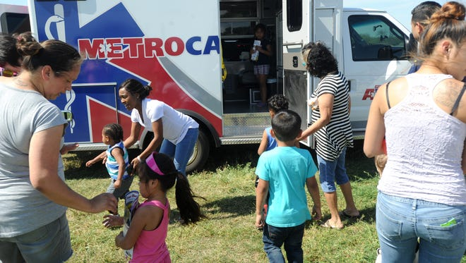 People tour an ambulance during the Crockett Early Childhood Safety Day.