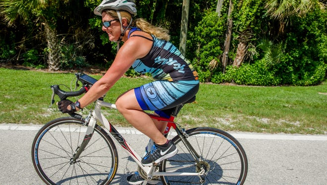 "Michelle McConville looks forward to the Aug. 5 Jupiter Medical Center Loggerhead Triathlon, but in a different way. ""I'm not doing this to compete. I'm not out there to beat anybody. I'm out there to do the event for me,"" she said."