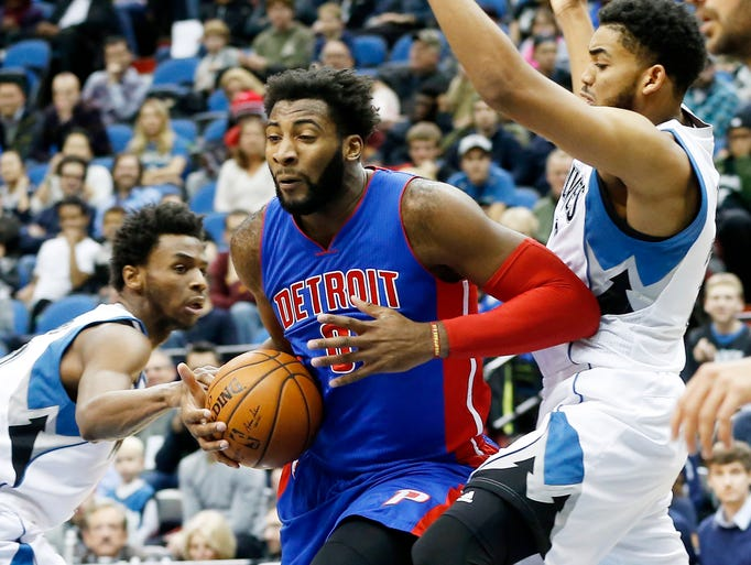 The Pistons'' Andre Drummond is defended by the Timberwolves''