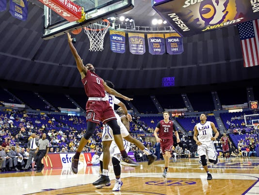 South Carolina guard Sindarius Thornwell (0) scores in front of defender LSU guard Antonio Blakeney (2) in the first half of an NCAA college basketball game, Wednesday, Feb. 1, 2017, in Baton Rouge, La. South Carolina won 88-63. (AP Photo/Bill Feig)