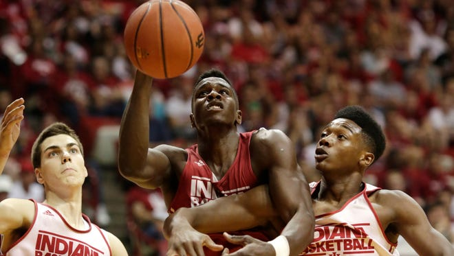 Indiana forward Hanner Mosquera-Perea, center, battled for the ball in traffic during a Hoosier Hysteria scrimmage Saturday, Oct. 25, at Assembly Hall in Bloomington.