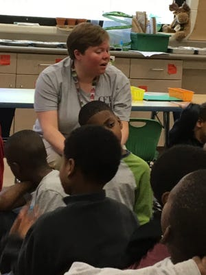 First grade teacher Bethany Glass talks to her students at Roselawn Condon Elementary School.