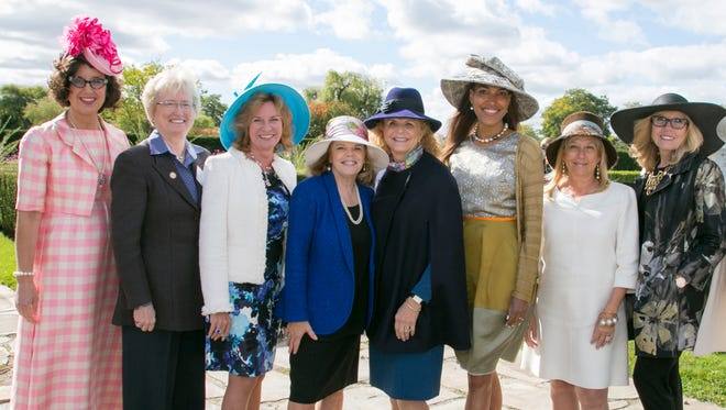 """Women showing off their hats at """"Polish the Jewel"""" fundraiser for Belle Isle Conservancy held Oct. 13 at Belle Isle. From left: Michele Hodges, Nancy Schlichting, B.eth Chappell, Nancy Posavetz, Sarah Earley, Shauna Diggs, Denise Ilitch and Joyce Jeneraux."""