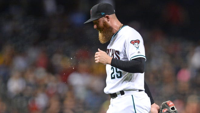 Jul 20, 2018; Phoenix, AZ, USA; Arizona Diamondbacks relief pitcher Archie Bradley (25) leaves the game against the Colorado Rockies during the seventh inning at Chase Field. Mandatory Credit: Joe Camporeale-USA TODAY Sports