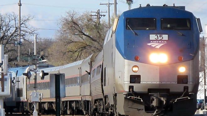 An eastbound Amtrak train comes through the Kalamazoo station.