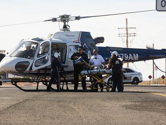 Student and actor Hannah Skyles is loaded on to a helicopter