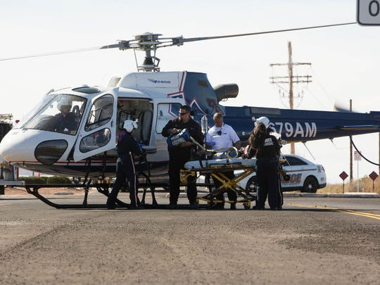 "Student and actor Hannah Skyles is loaded on to a helicopter outside of Oñate High School Thursday March 15, 2018 during ""Shattered Lives,"" a mock DWI crash production."