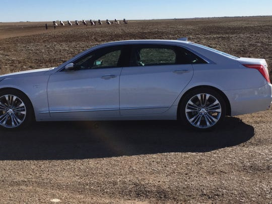 A 2016 Cadillac CT6 parked in front of the Cadillac ranch art installation on Route 66 in Amarillo, Texas.